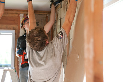 AmeriCorps member installing dry wall in Jeanie and Warner George's home, Joplin, MO. Corporation for National and Community Service Photo