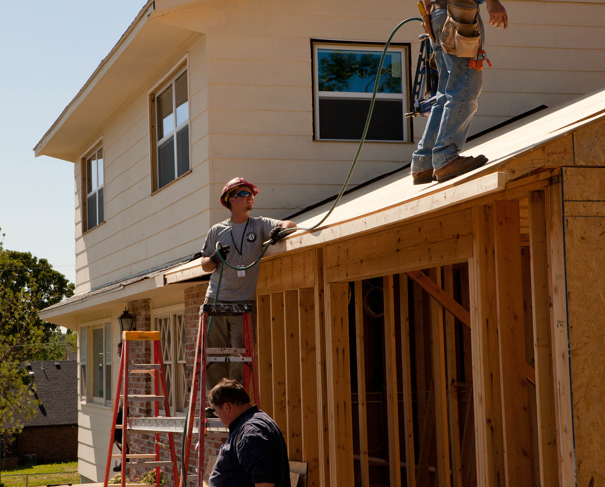 AmeriCorps member repairing Jeanie and Warner George's house which was devastated by the tornado in Joplin, MO. Corporation for National and Community Service Photo