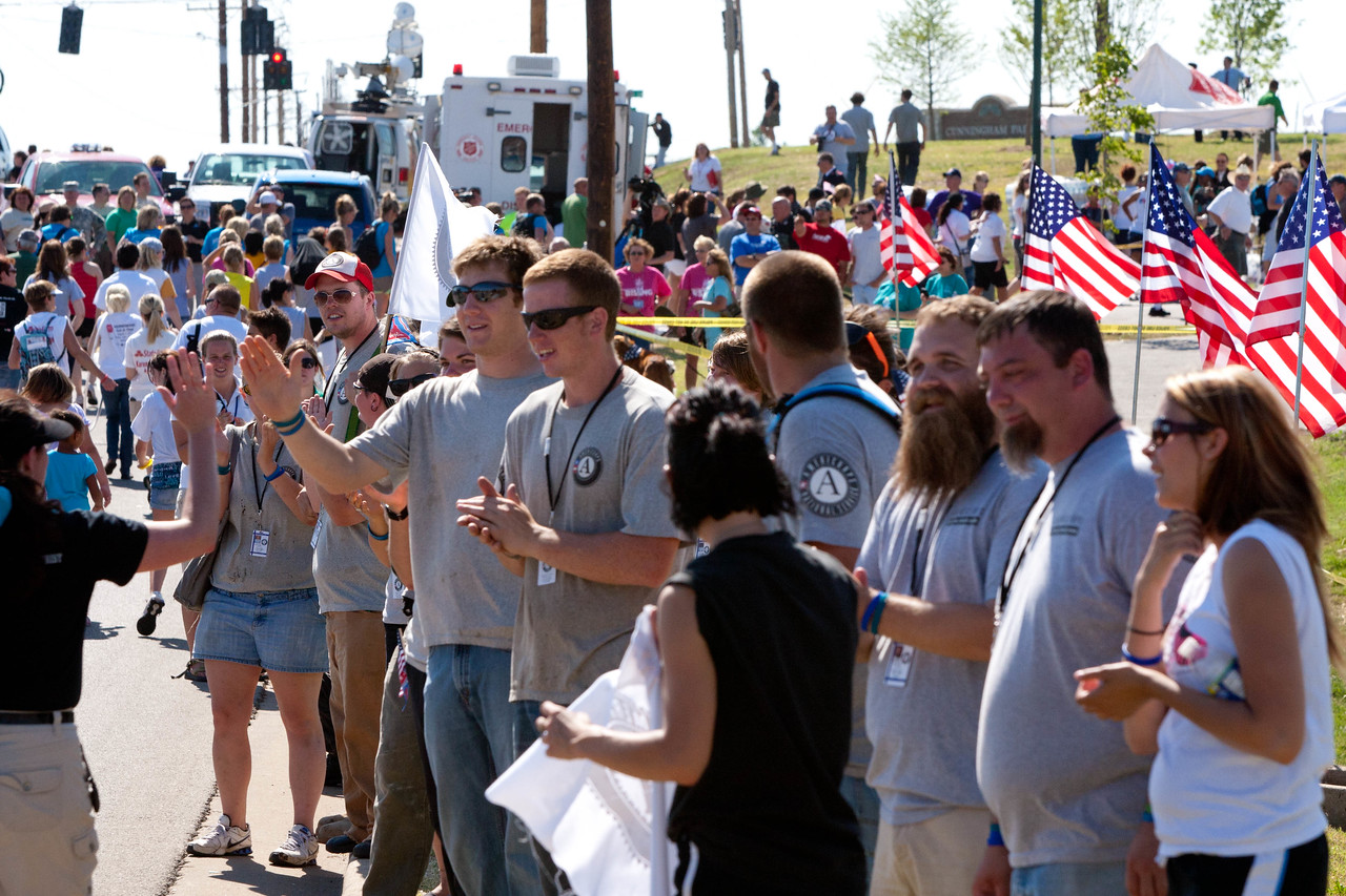 AmeriCorps members supporting people walking in the May 22 Unity Walk in Joplin, MO, marking the one-year anniversary of the 2011 tornado. Corporation for National and Community Service Photo