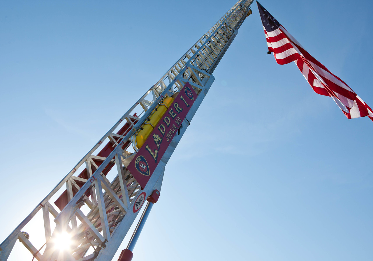 A flag flies from a the ladder of a Joplin Fire Department truck. Corporation for National and Community Service Photo