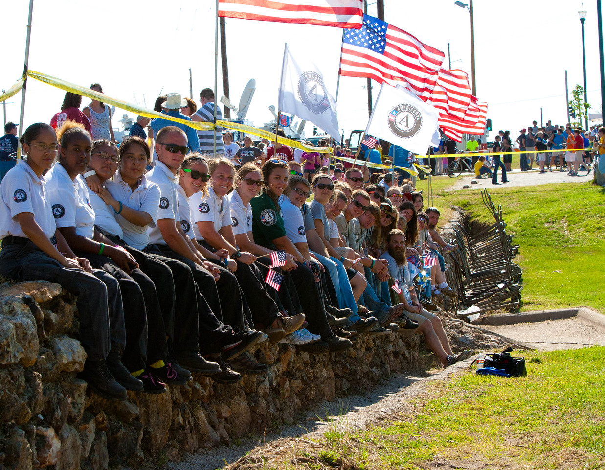 AmeriCorps members watching festivities after the Walk of Unity in Cunningham Park in Joplin, MO. Corporation for National and Community Service Photo