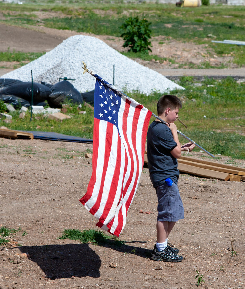 A boy carries an American flag during the City of Joplin's Walk of Unity marking the one-year anniversary of the devastating tornado that ravaged the city on May 22, 2011. Corporation for National and Community Service Photo