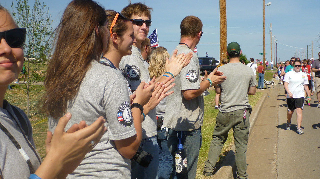 AmeriCorps members cheering on walkers at the Walk of Unity in Joplin, MO. Corporation for National and Community Service Photo.
