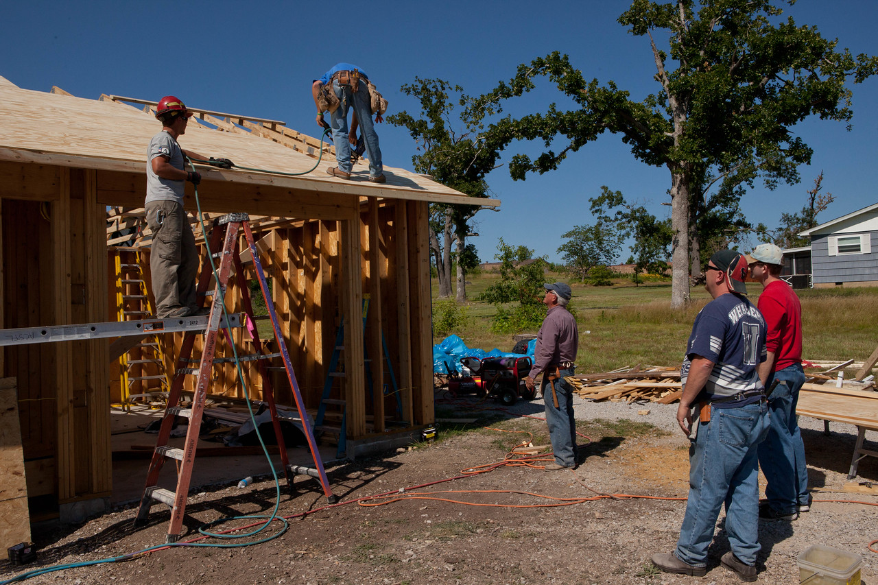Volunteers working outside of Jeanie and Warner George's home in Joplin, MO. Corporation for National and Community Service Photo