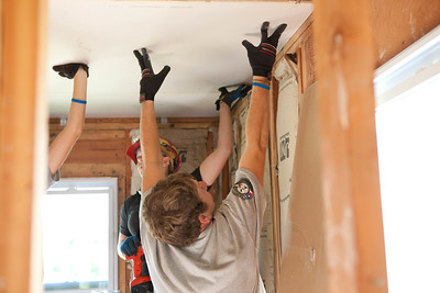 AmeriCorps members putting up dry wall in Jeanie and Warner George's house which was devastated by the tornado in Joplin, MO. Corporation for National and Community Service Photo