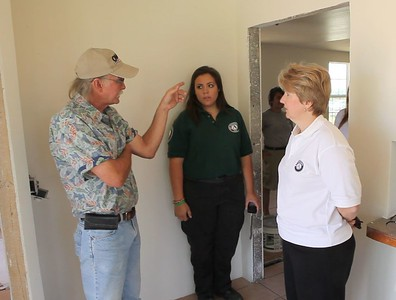 Dan Farren, Joplin resident, AmeriCorps member and Corporation for National and Community Service CEO, Wendy Spencer discuss the rebuilding of Mr. Farren's home that was impacted by the tornado in May 2011. Corporation for National and Community Service Photo.