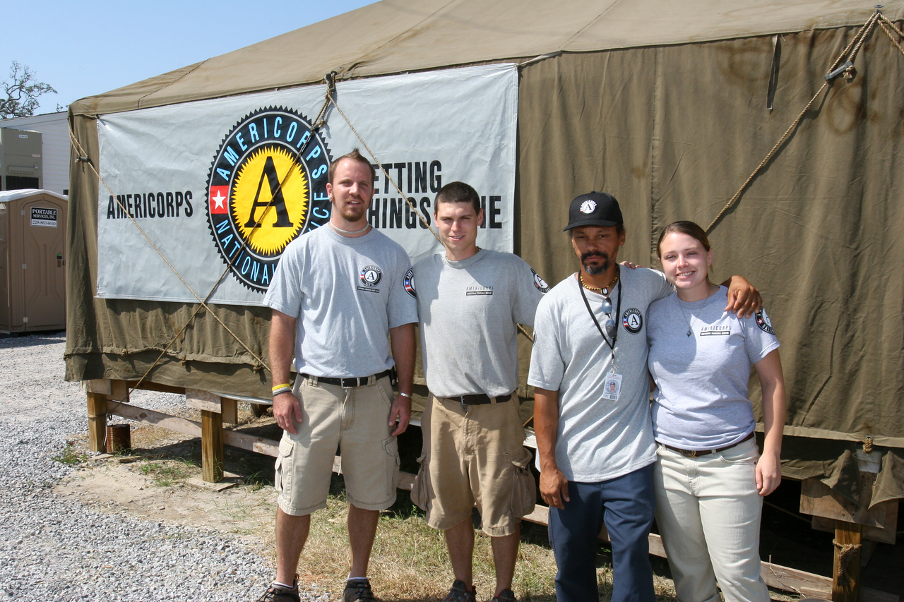 AmeriCorps members in Pass Christian, MS, help the community rebuild on the first anniversary of the Hurricane Katrina recovery in 2006. (Corporation for National and Community Service photo)
