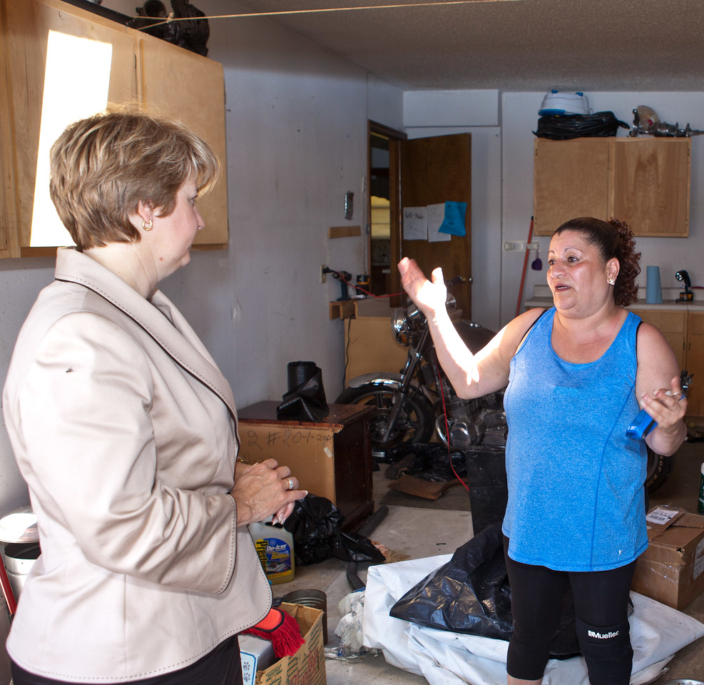 Resident in Moore, Oklahoma who's home was damaged by the tornado speaks with CNCS, CEO Wendy Spencer. Corporation for National and Community Service Photo.