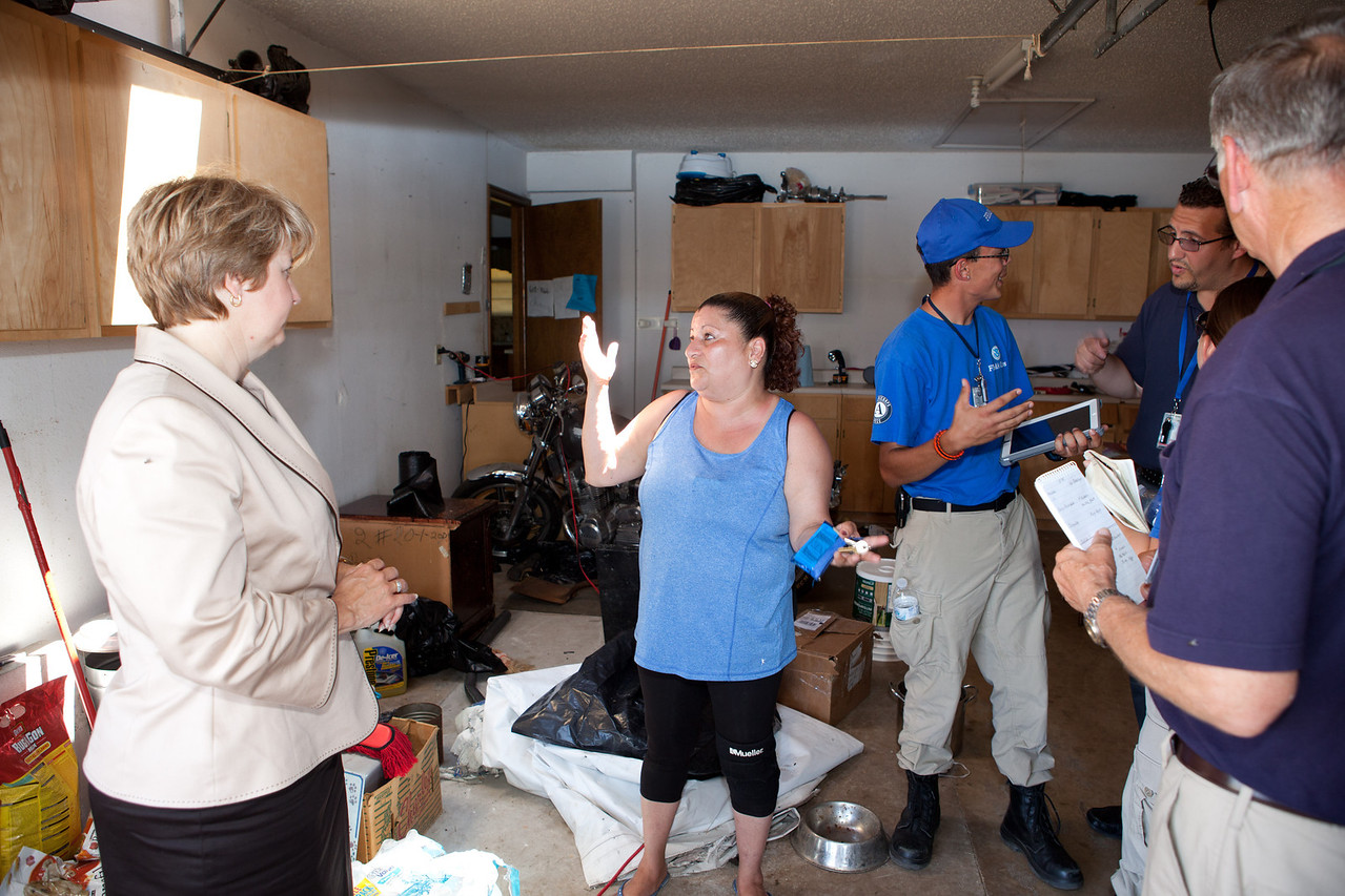 Resident in Moore, Oklahoma who's home was damaged by the tornado speaks with FEMA Corps members and CNCS, CEO Wendy Spencer. Corporation for National and Community Service Photo.