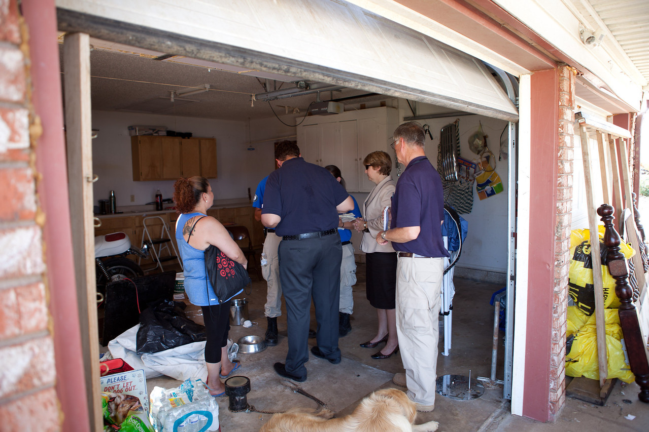 Resident in Moore, Oklahoma who's home was damaged by the tornado receives support from FEMA Corps and CNCS, CEO Wendy Spencer. Corporation for National and Community Service Photo.
