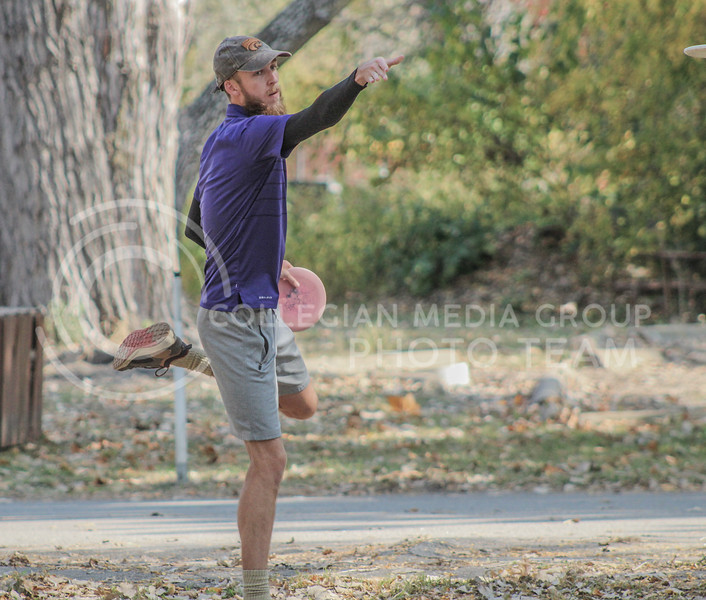 Standing on one leg, senior Seth Stirek watches the disc move toward the target.  (Photo by Macey Franko)