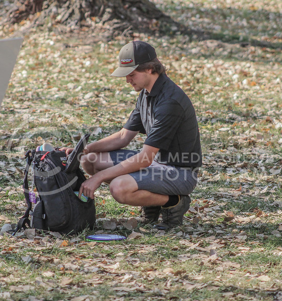 Looking through his backpack, senior Eli Smith switches his set of discs. (Photo by Macey Franko)
