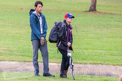 Antony Barela and his caddy Kona Panis wait to throw on hole no. 7.