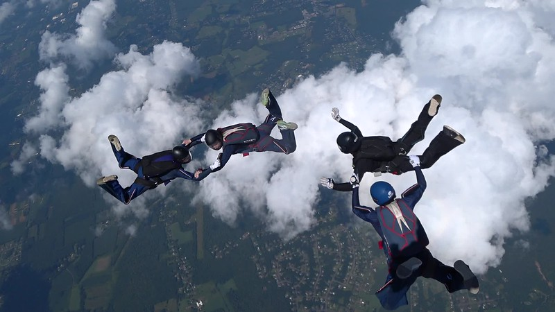 """Video of the 4-way jump. <br><span class=""""vidfilename"""" style=""""font-size:14px"""">2018-08-05_video_monique_4way</span><br><span class=""""musiccredit"""" style=""""font-size:14px"""">Wind noise. Mute the volume.</span>"""