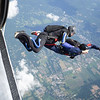 """Rob and Kerry exit. <br><span class=""""skyfilename"""" style=""""font-size:14px"""">2019-07-14_skydive_cpi_0500</span>"""