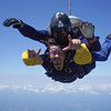 """Luis' tandem with Mike. <br><span class=""""skyfilename"""" style=""""font-size:14px"""">2019-08-04_skydive_cpi_0470</span>"""