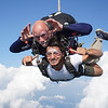 """Hasan's tandem with Mike. <br><span class=""""skyfilename"""" style=""""font-size:14px"""">2019-08-04_skydive_cpi_1139</span>"""