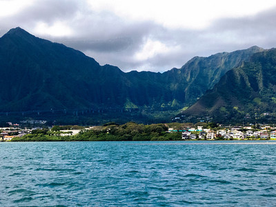 If you look carefully (larger image), you can see the Pali hidden in the shadow of the Ko'olau Mountain Range