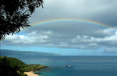 Rainbow over Waimea Bay on the North Shore of O'ahu.