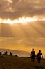 Surfers walking along the beach at sunset<br /> <br /> North Shore of O'ahu, Hawai'i