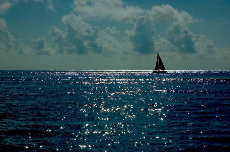 Sailboat at sunset<br /> <br /> Waikiki, Hawai'i