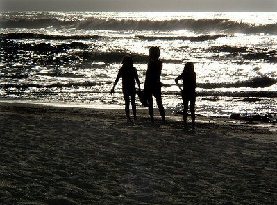 Silhouettes of children playing on the beach at sunsetSunset Beach, North Shore of O'ahu, Hawai'i