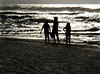 Silhouettes of children playing on the beach at sunset<br><br>Sunset Beach, North Shore of O'ahu, Hawai'i