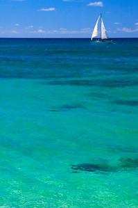 Sunset BeachSailboat sailing past Sunset Beach on a calm summer ocean in August North Shore, O'ahu, Hawai'i  082105.024831