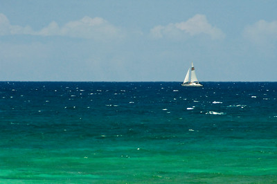 Laniakea Beach is also called Lani's Sailboat passing by