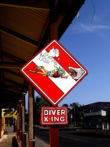 Diver Xing   signoutside the Surf N Sea surfshop between Hale'iwa Beach Park and the famous Rainbow Bridge over Anuhulu StreamHale'iwa, North Shore, Oahu, Hawaii