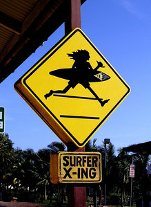 Surfer Xing  signoutside the Surf N Sea surfshop between Hale'iwa Beach Park and the famous Rainbow Bridge over Anuhulu StreamHale'iwa, North Shore, Oahu, Hawaii