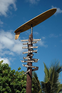 Directional sign to places nearby and around the Worldoutside the Surf N Sea surfshop between Hale'iwa Beach Park and the famous Rainbow Bridge over Anuhulu StreamHale'iwa, North Shore, Oahu, Hawaii