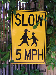 Slow signWatch out for kids North Shore, Oahu, Hawaii