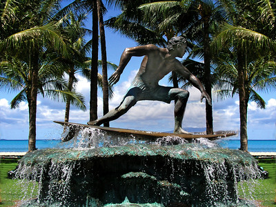 Statue fountain of surfer on the walk along Kalukau Ave. near the beach  Waikiki, Hawai'i