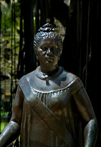 A statue of Queen Lili'uokalani.  Behind her is a banyon tree on the grounds of the 'Iolani Palace  Queen Lydia Lili'uokalani (September 2, 1838 - November 11, 1917