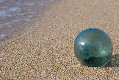 Vintage Green Sea Glass Floats are extremely rare find, an ultimate find for a dedicated beachcomber.  This one was found washed up on a remote Pacific Island beach by a wonderful young woman who helps save our Oceans by untangling and removing discarded, harmful fishing nets from coral reefs. She generously gifted this Sea Glass Ball to me.  Over a lifetime this glass ball may have floated across the Bering Sea from Asia, and into the Pacific Ocean.  They were once used by fishermen in many parts of the world to keep their nets afloat.  Large groups of fishnets strung together, sometimes 50 miles long, were set adrift in the ocean and supported near the surface by hollow glass balls or cylinders containing air to give them buoyancy.