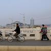 Citizens riding bikes