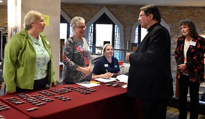 Archbishop Christophe Pierre, Apostolic Nuncio to the United States, checks in for the symposium