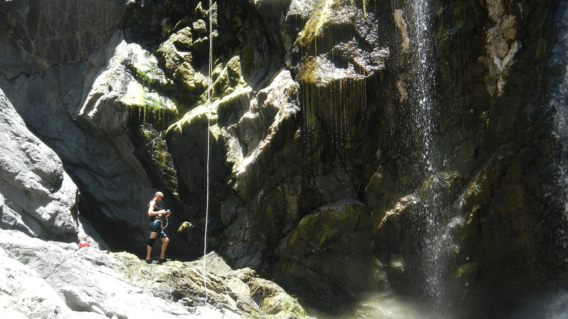"Dominic Colvile in ""The Showerroom"" at the foot of Top Plunge, Yabba Falls after having abseiled down through the falls, 15/12/2012. Photographer: Marjon de Boer"