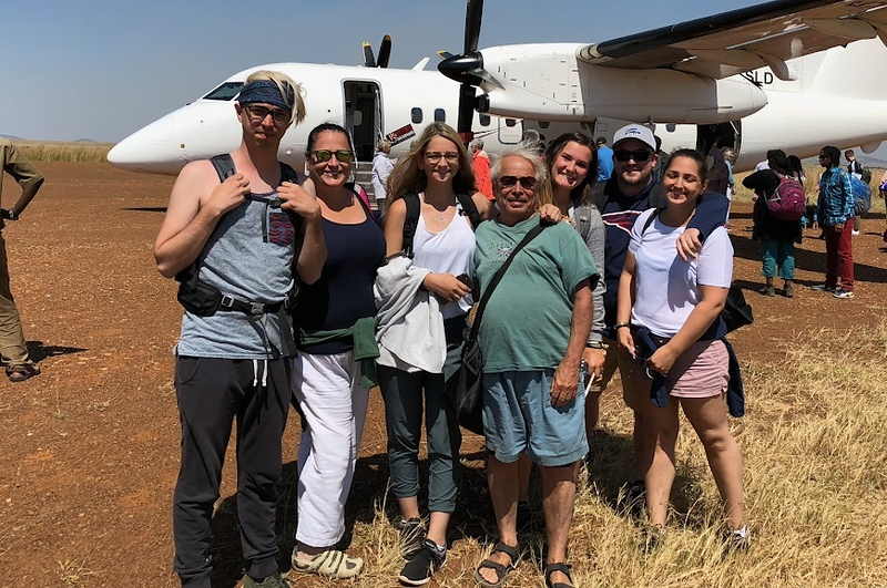 . At the Keekorok Airstrip at the Maasai Mara National Reserve, from left: Adam Scopa, Shannon Scopa, Emma Scopa, Ralph Scopa, Emily Chmela, Brian Perry and Caity Scopa. COURTESY PHOTO