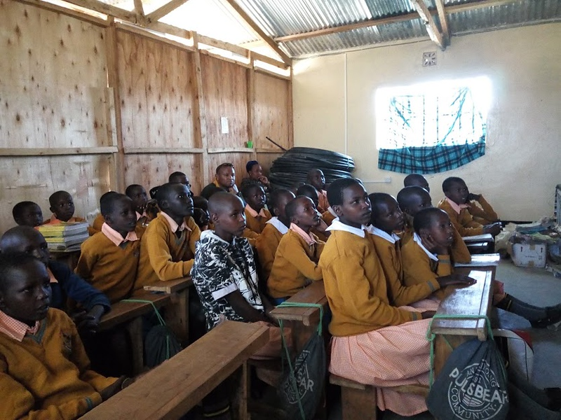 . Emma Scopa and Emily Chmela, both 17-year-old Tewksbury Memorial High School seniors, brought school supplies to the Embiti Primary School in Kenya during a family trip. Now, they are raising funds for a new school building there. COURTESY PHOTO