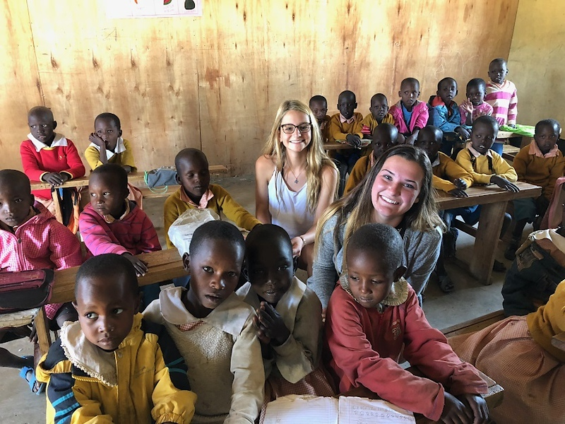 . Tewksbury Memorial High School seniors Emma Scopa and Emily Chmela brought school supplies to the Embiti Primary School in Kenya during a family trip. COURTESY PHOTO
