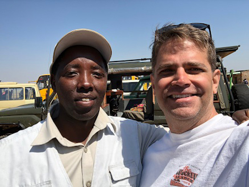. Mike Scopa, of Tewksbury, and Joel, one of his safari guides, during a family trip to Kenya in July. COURTESY PHOTO
