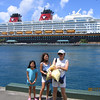 Heather, Evelyn, and JoMay in from of the Disney Wonder