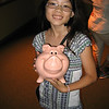 Evelyn with her piggy bank