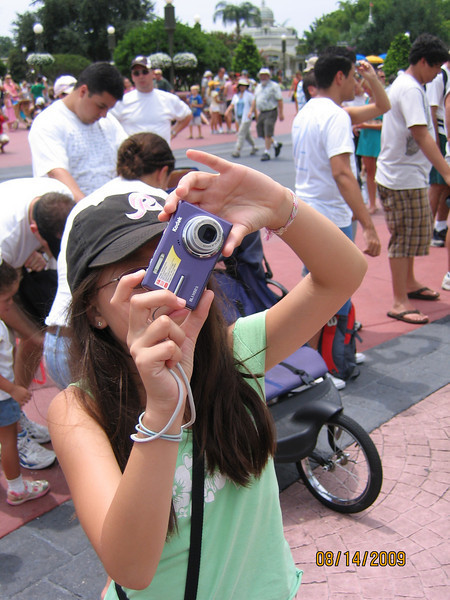 Evelyn taking a picture of Cinderella Castle