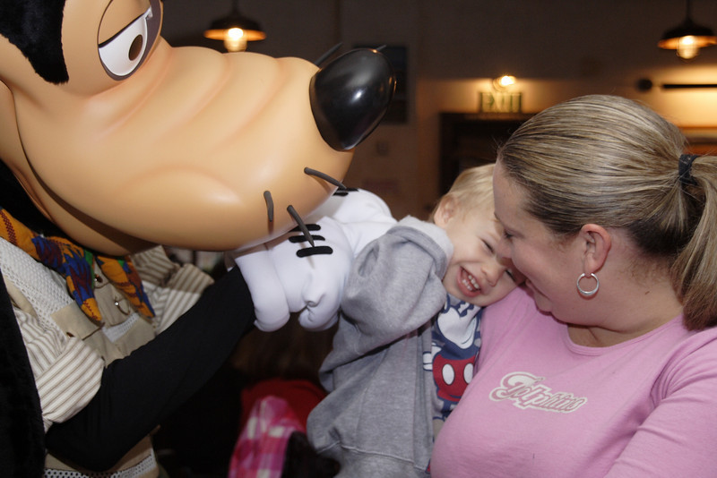 Jonathan was very ticklish that day...and Goofy knew it.