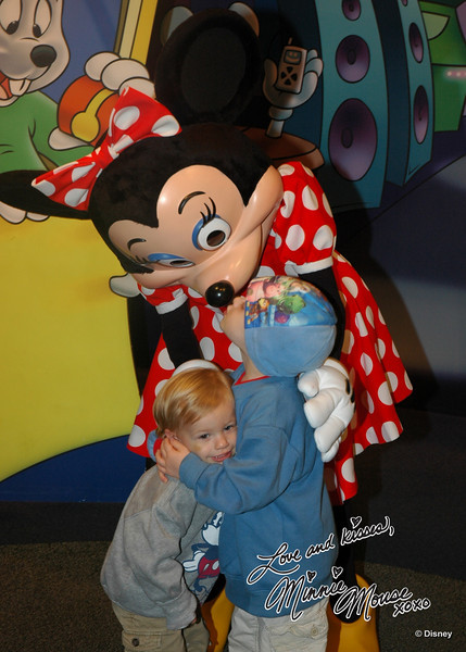 Hugging his brother, while kissing Minnie :)