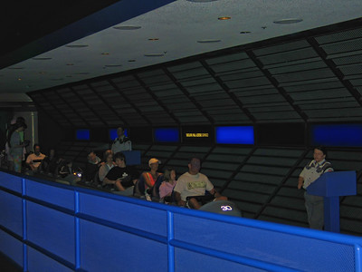 A dark picture of loading area in Space Mountain
