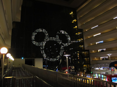 Lighted wreath on the outside of the Contemporary viewed from the monorail station